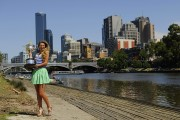 Виктория Азаренко, фото 193. Victoria Azarenka Posing with the Australian Open Trophy along the Yarra River in Melbourne - 29.01.2012, foto 193