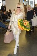 Памела Андерсон, фото 4987. Pamela Anderson arrival at Vienna International Airport, march 4, foto 4987
